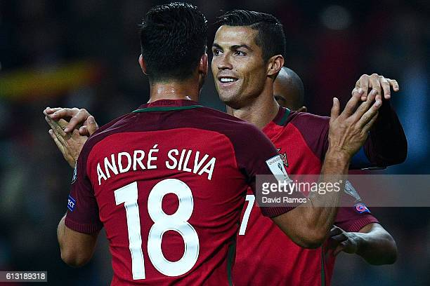 Cristiano Ronaldo of Portugal celebrates with his team mate Andre Silva after scoring his team's fourth goal during the FIFA 2018 World Cup Qualifier...