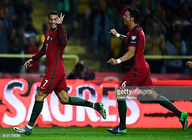 Cristiano Ronaldo of Portugal celebrates with his team mate Jose Fonte of Portugal after scoring his team's first goal during the FIFA 2018 World Cup...