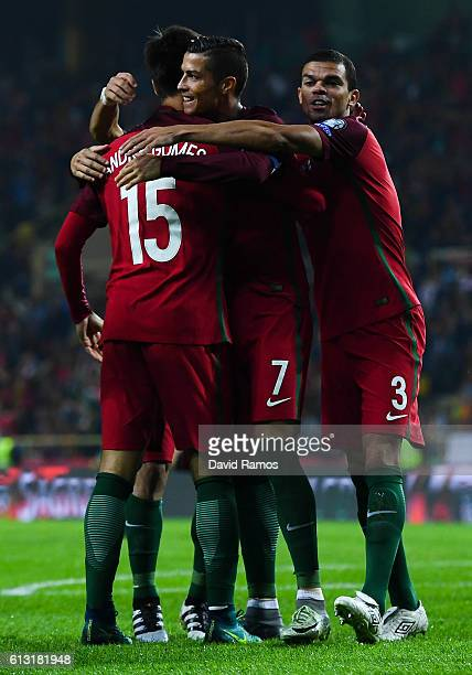 Cristiano Ronaldo of Portugal celebrates with his team mates after scoring his team's fourth goal during the FIFA 2018 World Cup Qualifier between...
