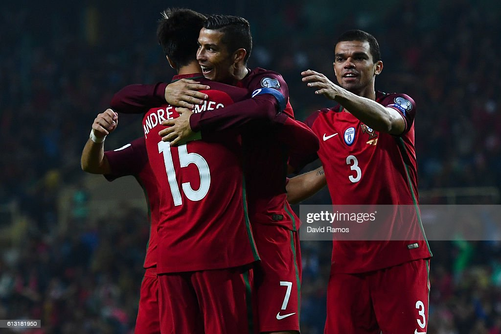 Cristiano Ronaldo of Portugal celebrates with his team mates after scoring his team's fourth goal during the FIFA 2018 World Cup Qualifier between Portugal and Andorra at Estadio Municipal de Aveiro on October 7, 2016 in Aveiro, Portugal.