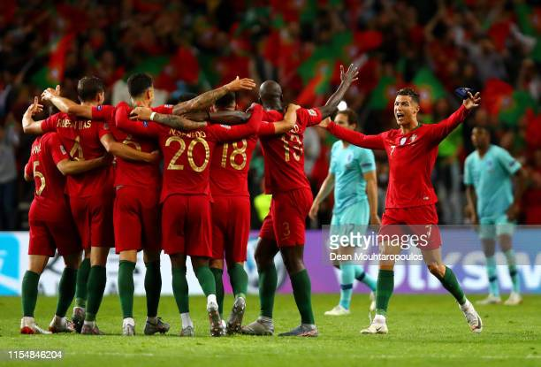 Cristiano Ronaldo of Portugal celebrates with his teammates following their victory in the UEFA Nations League Final between Portugal and the...