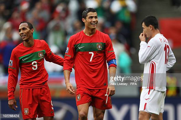 Cristiano Ronaldo of Portugal celebrates with team mate Liedson after scoring the seventh goal while Pak Chol-Jin of North Korea looks dejected...