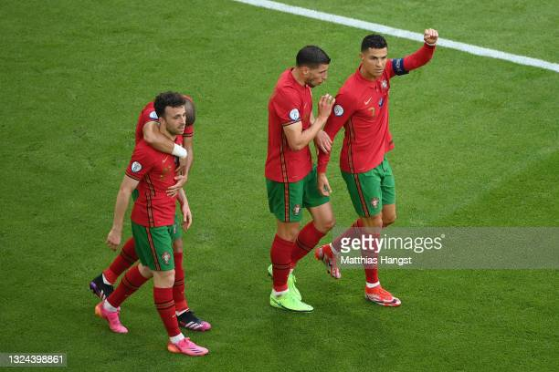 Cristiano Ronaldo of Portugal celebrates with team mates after scoring their side's first goal during the UEFA Euro 2020 Championship Group F match...