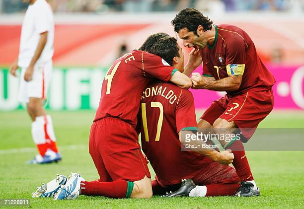 Cristiano Ronaldo of Portugal celebrates with team mates Luis Figo and Nuno Valente after scoring his team's second goal from the penalty spot during...