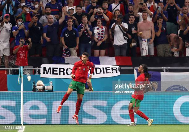 Cristiano Ronaldo of Portugal celebrates with teammate Renato Sanches after scoring their side's second goal from the penalty spot during the UEFA...
