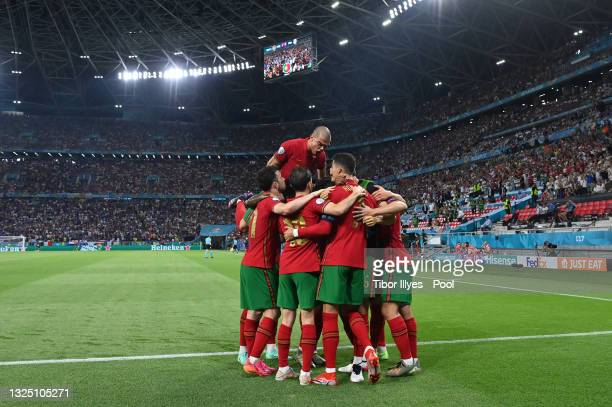Cristiano Ronaldo of Portugal celebrates with teammates after scoring their side's first goal during the UEFA Euro 2020 Championship Group F match...