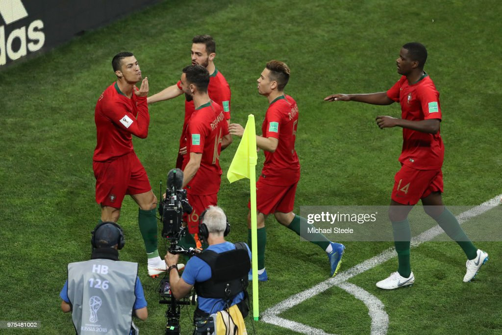 Cristiano Ronaldo of Portugal celebrates with teammates after scoring a penalty for his team's first goal during the 2018 FIFA World Cup Russia group B match between Portugal and Spain at Fisht Stadium on June 15, 2018 in Sochi, Russia.