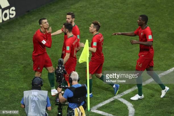 Cristiano Ronaldo of Portugal celebrates with teammates after scoring a penalty for his team's first goal during the 2018 FIFA World Cup Russia group...