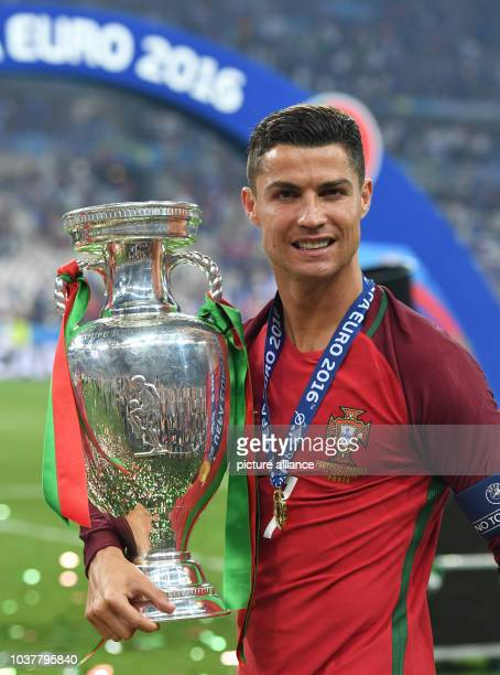 Cristiano Ronaldo of Portugal celebrates with the trophy after winning the UEFA EURO 2016 soccer Final match between Portugal and France at the Stade...