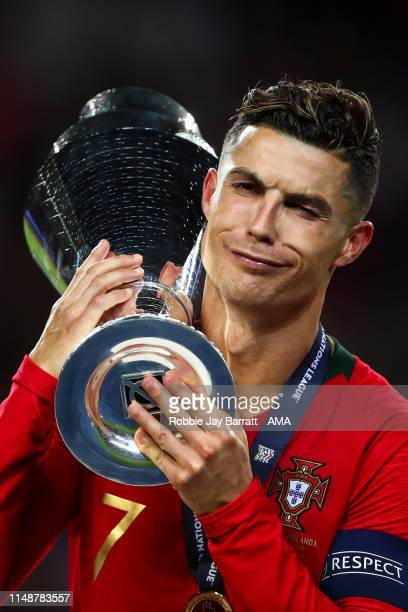Cristiano Ronaldo of Portugal celebrates with the trophy during the UEFA Nations League Final between Portugal and the Netherlands at Estadio do...