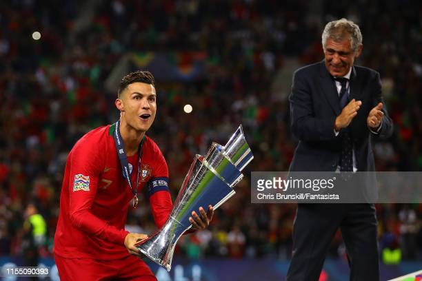 Cristiano Ronaldo of Portugal celebrates with the trophy following the UEFA Nations League Final between Portugal and the Netherlands at Estadio do...