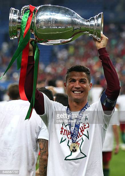 Cristiano Ronaldo of Portugal celebrates with the trophy following the UEFA Euro 2016 Final match between Portugal and France at Stade de France on...