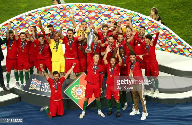 Cristiano Ronaldo of Portugal celebrates with the UEFA Nations League Trophy following his team's victory in the UEFA Nations League Final between...