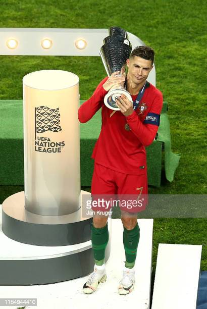 Cristiano Ronaldo of Portugal celebrates with the UEFA Nations League Trophy following his team's victory during the UEFA Nations League Final...