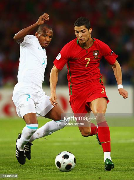 Cristiano Ronaldo of Portugal challenges Mehmet Aurelio of Turkey during the UEFA EURO 2008 Group A match between Portugal and Turkey at Stade de...