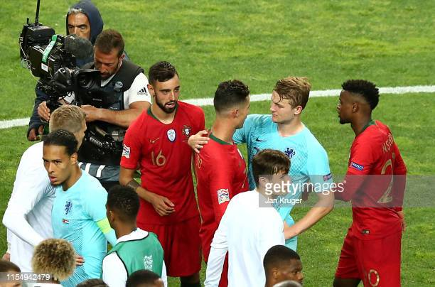 Cristiano Ronaldo of Portugal chats with Matthijs de Ligt of the Netherlands after the final whistle during the UEFA Nations League Final between...
