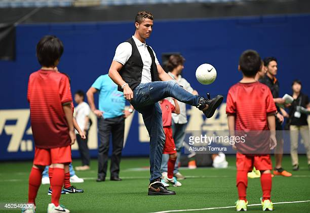 """Cristiano Ronaldo of Portugal coaches kids in the football class as part of MTG X Christiano Ronald """"Athletic Beauty Project"""" at Nagoya Dome on July..."""