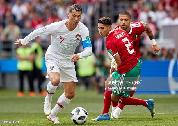 Cristiano Ronaldo of Portugal competes for the ball with Achraf Hakimi of Morocco during the 2018 FIFA World Cup Russia group B match between...