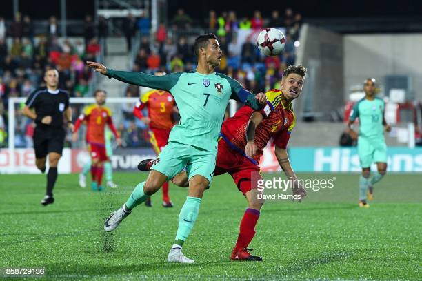 Cristiano Ronaldo of Portugal competes for the ball with Marc Rebes of Andorra during the FIFA 2018 World Cup Qualifier between Andorra and Portugal...