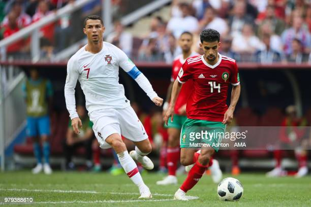 Cristiano Ronaldo of Portugal competes with Mbark Boussoufa of Morocco during the 2018 FIFA World Cup Russia group B match between Portugal and...