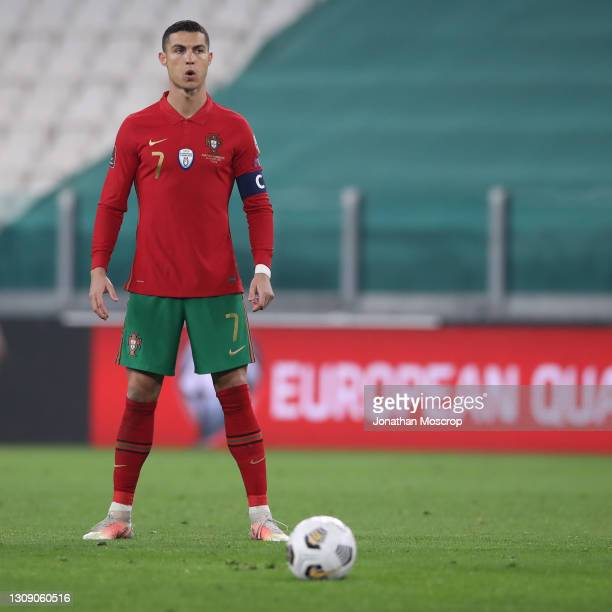 Cristiano Ronaldo of Portugal composes himself before taking a free kick during the FIFA World Cup 2022 Qatar qualifying match between Portugal and...
