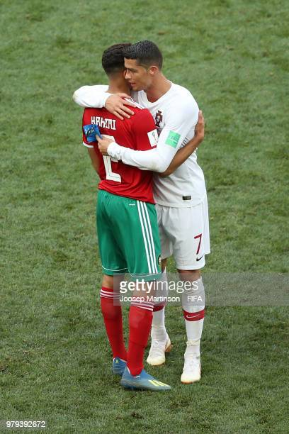 Cristiano Ronaldo of Portugal consoles Achraf Hakimi of Morocco during the 2018 FIFA World Cup Russia group B match between Portugal and Morocco at...