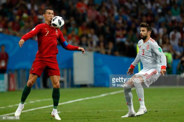 Cristiano Ronaldo of Portugal controls the ball against Gerard Pique of Spain during the 2018 FIFA World Cup Russia group B match between Portugal...