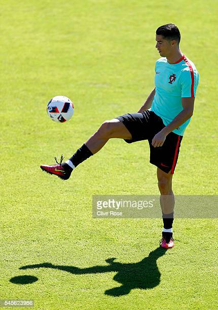 Cristiano Ronaldo of Portugal controls the ball during a training session ahead of the UEFA Euro 2016 Final against France at the Centre National de...