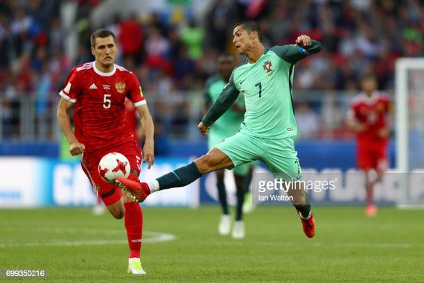Cristiano Ronaldo of Portugal controls the ball during the FIFA Confederations Cup Russia 2017 Group A match between Russia and Portugal at Spartak...