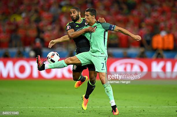 Cristiano Ronaldo of Portugal controls the ball under pressure of Ashley Williams of Wales during the UEFA EURO 2016 semi final match between...