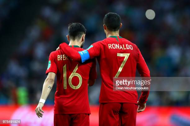Cristiano Ronaldo of Portugal embraces team mate Bruno Fernandes during the 2018 FIFA World Cup Russia group B match between Portugal and Spain at...
