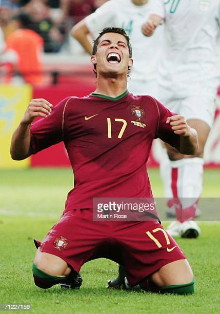 Cristiano Ronaldo of Portugal falls to his knees in celebration after scoring his team's second goal from the penalty spot during the FIFA World Cup...