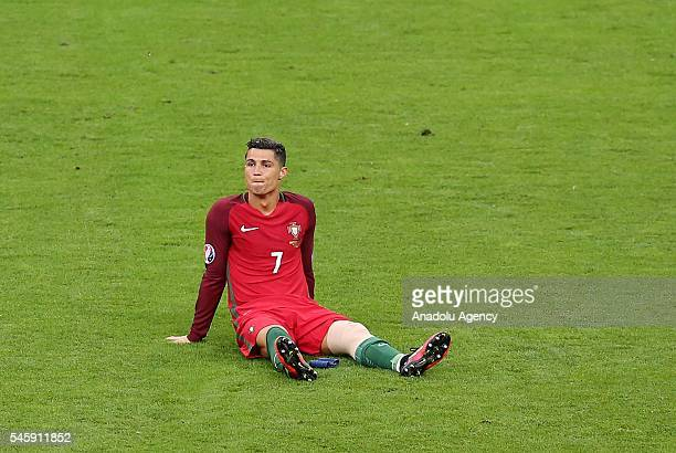 Cristiano Ronaldo of Portugal gets injured during the Euro 2016 final match between Portugal and France at Stade de France in Paris France on July 10...