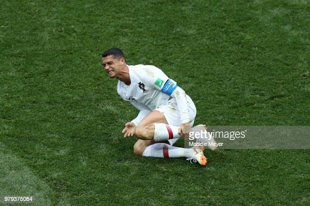 Cristiano Ronaldo of Portugal goes down injured during the 2018 FIFA World Cup Russia group B match between Portugal and Morocco at Luzhniki Stadium...