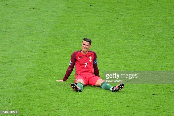 Cristiano Ronaldo of Portugal goes down injured for a second time during the European Championship Final between Portugal and France at Stade de...