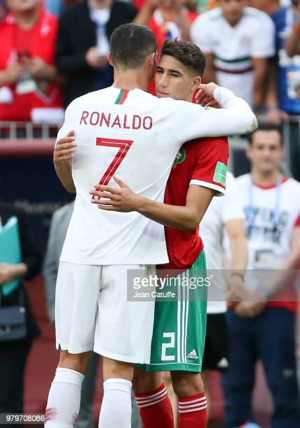 Cristiano Ronaldo of Portugal greets Achraf Hakimi of Morocco following the 2018 FIFA World Cup Russia group B match between Portugal and Morocco at...