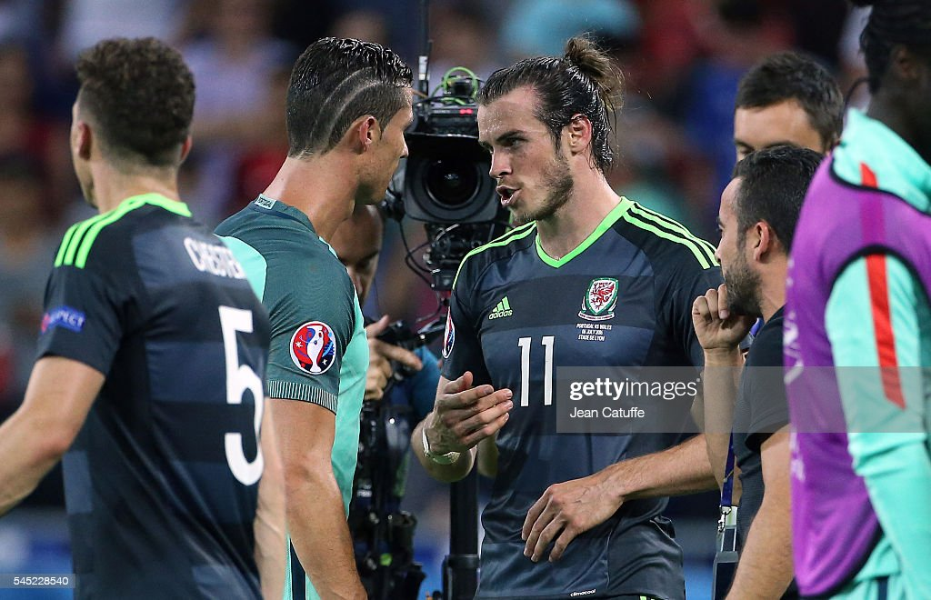 Cristiano Ronaldo of Portugal greets Gareth Bale of Wales following the UEFA Euro 2016 semi-final between Wales and Portugal at Parc OL, Stade des Lumieres on July 6, 2016 in Lyon, France.