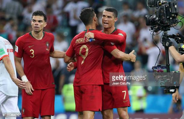 Cristiano Ronaldo of Portugal greets teammates Pepe Andre Silva following the 2018 FIFA World Cup Russia group B match between Portugal and Spain at...