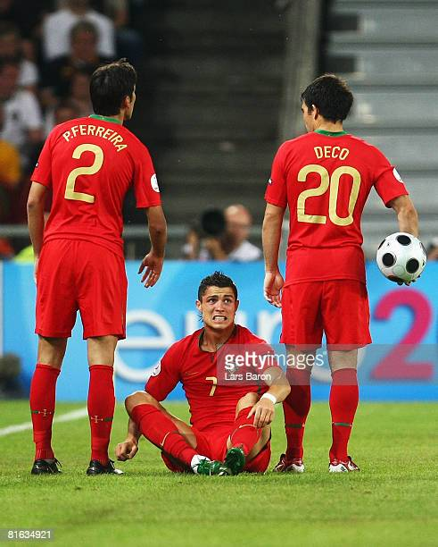 Cristiano Ronaldo of Portugal grimaces as Paulo Ferreira and Deco of Portugal look on during the UEFA EURO 2008 Quarter Final match between Portugal...