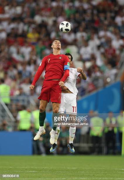 Cristiano Ronaldo of Portugal heads for the ball with Vahid Amiri of Iran during the 2018 FIFA World Cup Russia group B match between Iran and...