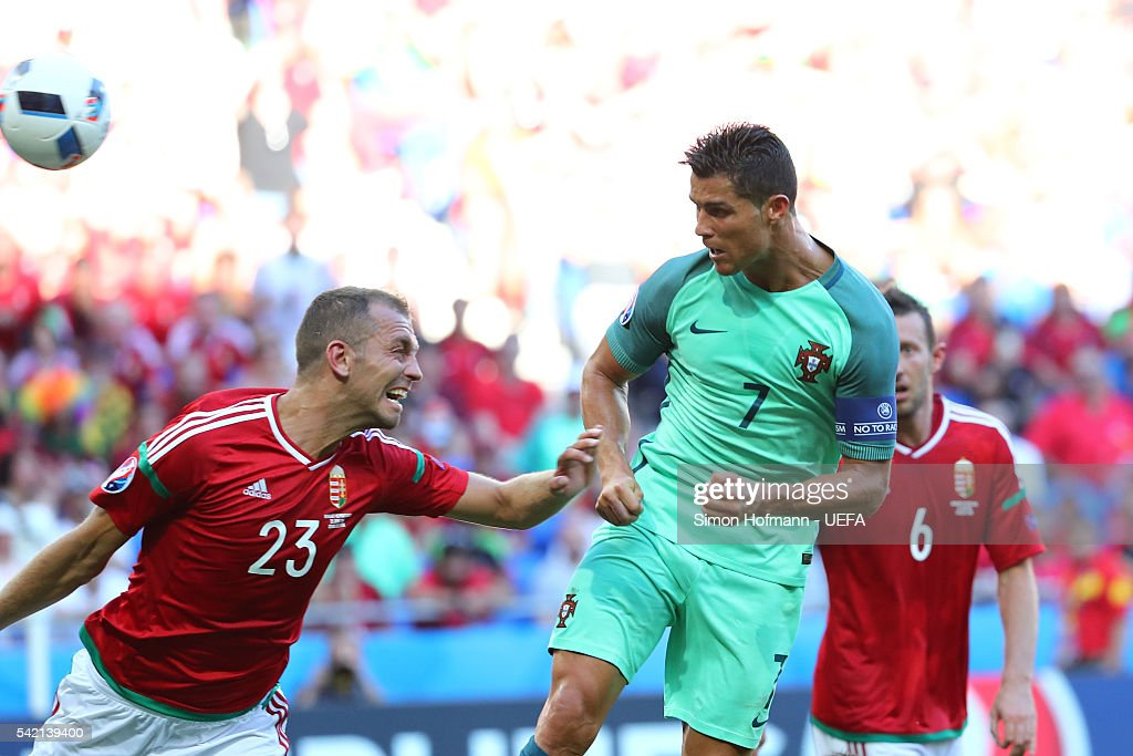 Cristiano Ronaldo of Portugal heads the ball to score his team's third goal during the UEFA EURO 2016 Group F match between Hungary and Portugal at Stade des Lumieres on June 22, 2016 in Lyon, France.