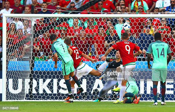 Cristiano Ronaldo of Portugal heads the ball to score his team's third goal during the UEFA EURO 2016 Group F match between Hungary and Portugal at...