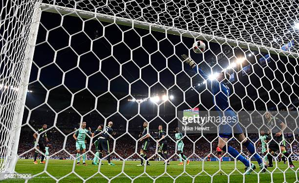 Cristiano Ronaldo of Portugal heads the ball to score the opening goal past Wayne Hennessey during the UEFA EURO 2016 semi final match between Wales...