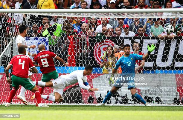 Cristiano Ronaldo of Portugal heads the opening goal during the 2018 FIFA World Cup Russia group B match between Portugal and Morocco at Luzhniki...