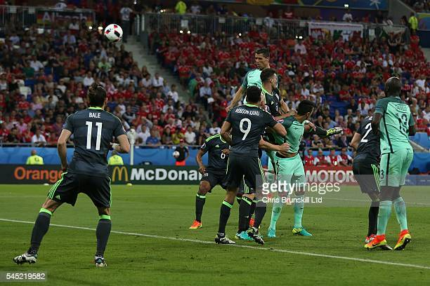Cristiano Ronaldo of Portugal heads the opening goal during the UEFA Euro 2016 Semi Final match between Portugal and Wales at Stade de Lyon on July...