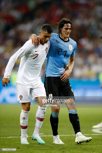 Cristiano Ronaldo of Portugal helps Edinson Cavani of Uruguay off the pitch after he gets injured during the 2018 FIFA World Cup Russia Round of 16...