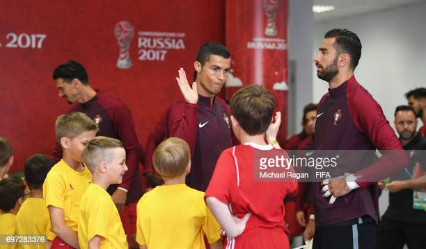 Cristiano Ronaldo of Portugal high fives player escorts in the tunnel prior to the FIFA Confederations Cup Russia 2017 Group A match between Portugal...