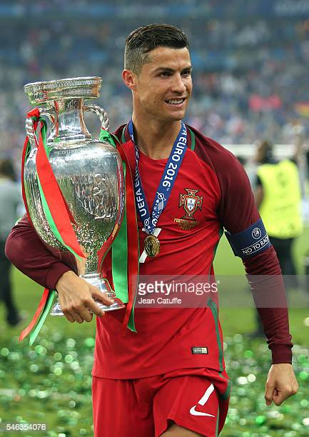Cristiano Ronaldo of Portugal holds the trophy following the UEFA Euro 2016 final between Portugal and France at Stade de France on July 10 2016 in...