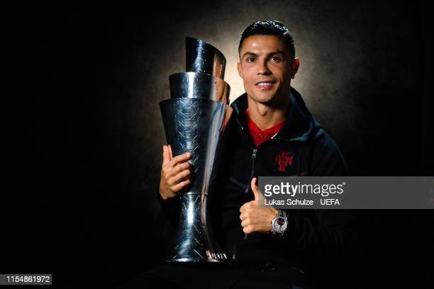 Cristiano Ronaldo of Portugal holds with the UEFA Nations League Trophy during an interview following his team's victory in the UEFA Nations League...