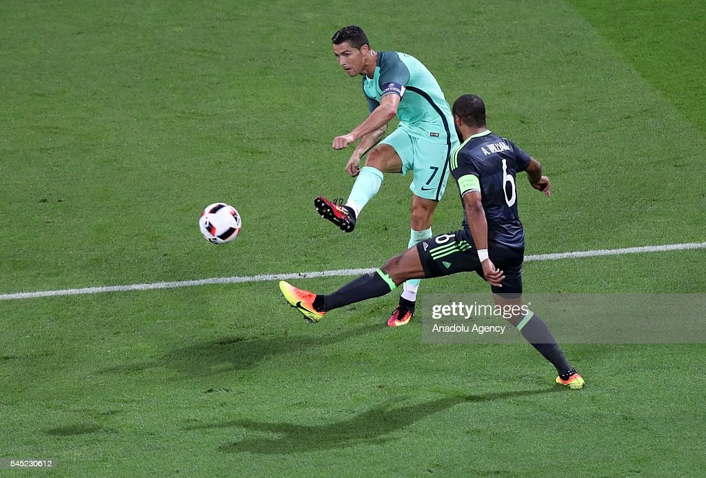 Cristiano Ronaldo (7) of Portugal in action against Ashley Williams of Wales during the UEFA Euro 2016 semi final match between Portugal and Wales at Stade de Lyon in Lyon, France on July 6, 2016.